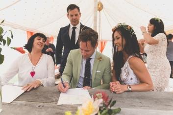 Bride, Groom & Celebrant Sign Wedding register